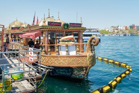 Istanbul, Turkey - April 25, 2017: Traditional fast food bobbing boat serving fish sandwiches at Eminonu with chefs preparing meals Stock Photo - 133072455