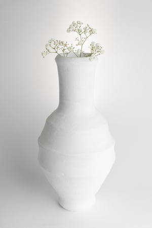 Still life composition of white pottery vase and small white flowers on white background Stock Photo - 127441448