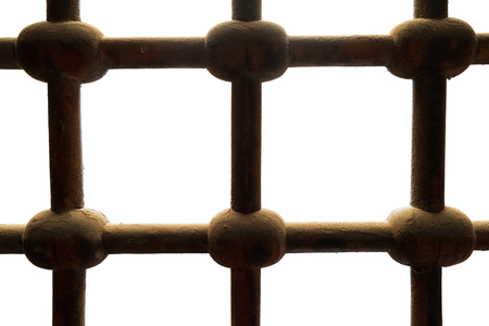 Old rusted grunge ornate intersected iron bars window isolated on white, includes clipping path Stock Photo - 127441483