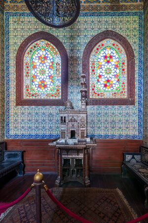 Turkish ceramic tiles wall, ornate ceiling and stained glass windows, Residence hall at Manial Palace of Prince Mohammed Ali, Cairo, Egypt Stock Photo - 133072765