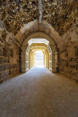 Mamluk era arched stones tunnel leading to Al-Muayyad Bimaristan (ancient hospital), Darb El Labbana district, Cairo, Egypt Stock Photo - 127702333