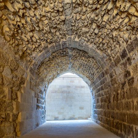 Mamluk era arched stones tunnel leading to Al-Muayyad Bimaristan (ancient hospital), Darb El Labbana district, Cairo, Egypt Stock Photo - 127298920