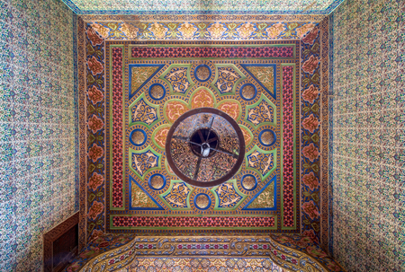 Royal era colorful engraved wooden ceiling with floral pattern decorations at historic Manial palace of Prince Mohammed Ali, Cairo, Egypt - open for public visits Stock Photo - 127298924