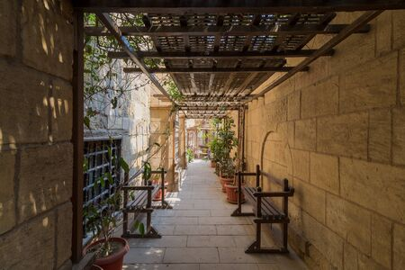 Passage ceiled with wooden pergola leading to the House of Egyptian Architecture historical building from the Mamluk era, Cairo, Egypt