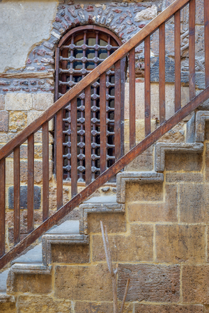 Wooden window and staircase with wooden balustrade leading to historic Beit El Set Waseela building (Waseela Hanem House), Old Cairo, Egypt Stock Photo - 127467276