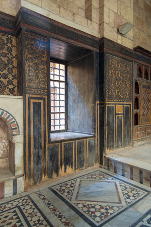 Hall at ottoman era historic house of Moustafa Gaafar Al Seleehdar located at Al Darb Al Asfar District, Cairo, Egypt with decorated wooden wall and marble floor Stock Photo - 127467280