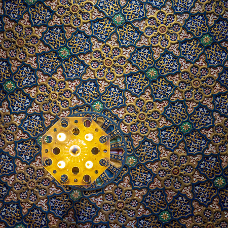 Colorful wooden ornate ceiling with floral and geometrical patterns at historic Manial Palace of Prince Mohammed Ali Tewfik, Cairo, Egypt Stock Photo - 127467298
