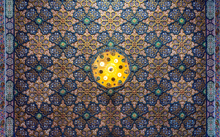 Colorful wooden ornate ceiling with floral and geometrical patterns at historic Manial Palace of Prince Mohammed Ali Tewfik, Cairo, Egypt Stock Photo - 127467299