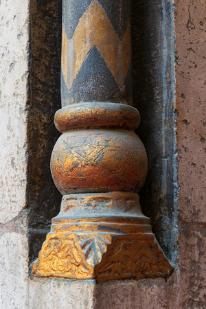 Golden base of a small decorative pillar (column) with engraved floral inscriptions at the ancient public mosque of Sultan Hassan, Old Cairo, Egypt Stock Photo - 127467310