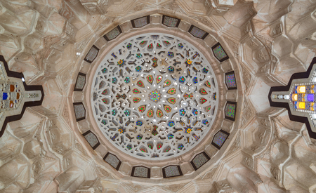 Ottoman era carved plaster dome decorated with colored glass pieces of a pergola in front of El sehemy historical house, El Moez street, Cairo, Egypt Stock Photo - 127467564