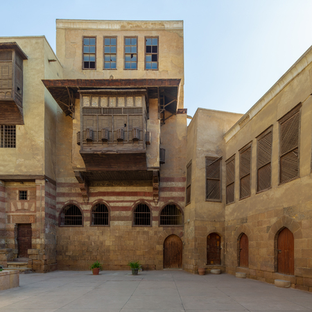 Facade of Zeinab Khatoun historic house, located near to Al-Azhar Mosque in Darb Al-Ahmar district, Old Cairo, Egypt Stock Photo - 127467566