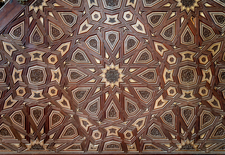 Closeup of arabesque ornaments of old aged decorated minbar of Sultan al Nasir Muhammad ibn Qalawun Mosque, Old Cairo, Egypt Stock Photo - 127467568
