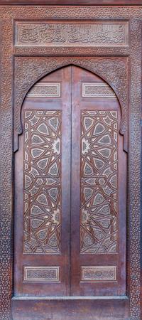 Wooden ornate door of platform (Minbar) of the Mosque of Al Nasir Mohammad Ibn Qalawun at the Citadel of Cairo, Egypt Stock Photo - 127467570