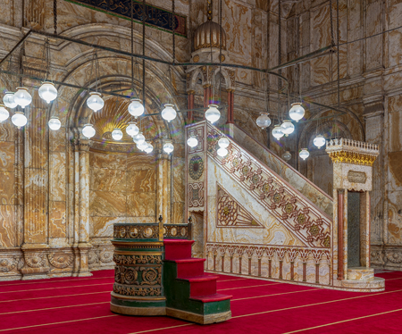 Decorated alabaster (marble) wall with engraved niche (Mihrab) and Platform (Minbar) at the great Mosque of Muhammad Ali Pasha (Alabaster Mosque), situated in the Citadel of Cairo in Egypt Stock Photo - 127467571