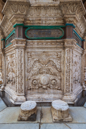White marble carved wall of an ablution fountain at the courtyard of the great Mosque of Muhammad Ali Pasha, Citadel of Cairo, Egypt Stock Photo - 127467580