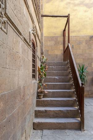 Old stone stair case with wooden balustrade leading to historic Beit Zeinab Khatoun building (Zeinab Khatoun House), Old Cairo, Egypt Stock Photo - 127467583
