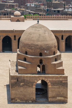 Aerial view of ablution fountain at the courtyard of Ibn Tulun public historical mosque, Old Cairo, Egypt Stock Photo - 127467588