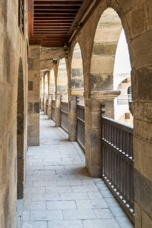 One of the arcades surrounding the courtyard of caravansary, arabic: Wikala of Bazaraa, Medieval Cairo, Egypt Stock Photo - 131871039
