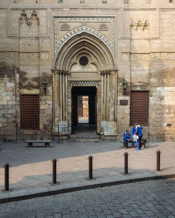 Cairo, Egypt- December 12 2015: Entrance of theological school and Mausoleum of Sultan Qalawun, Moez Street Stock Photo - 133073234