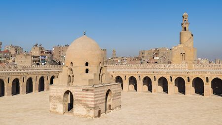 Courtyard of Ibn Tulun public historical mosque with ablution fountain and the minaret, Sayyida Zaynab district, Medieval Cairo, Egypt Stock Photo - 131871170