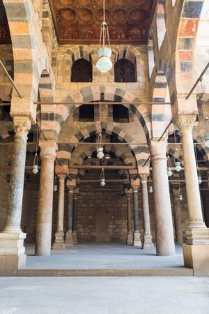 Corridor surrounding the courtyard of the public historical Mosque of al Sultan al Nasir Muhammad Ibn Qalawun situated in the Citadel of Cairo in Egypt Stock Photo