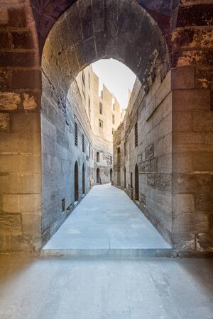 Narrow passage with old grunge stone walls leading to Sultan Hasan Mosque, Cairo, Egypt Stock Photo - 131870439