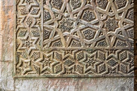 Ornaments of the bronze-plate ornate door of Sultan Qalawun mosque, an ancient historic mosque in Old Cairo, Egypt Stock Photo - 131870970