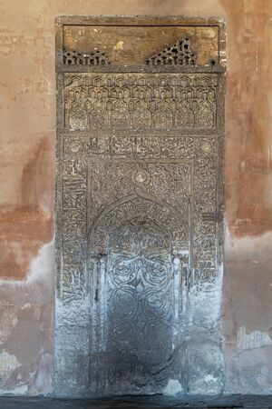 Cairo, Egypt- September 16 2017: Decorated engraved stone wall with floral patterns and Arabic calligraphy at Ibn Tulun Mosque Stock Photo - 133073761