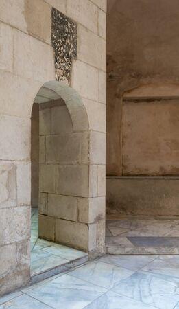 Aged narrow vaulted passage and stone bricks wall, Medieval Cairo, Egypt Stock Photo - 131870537