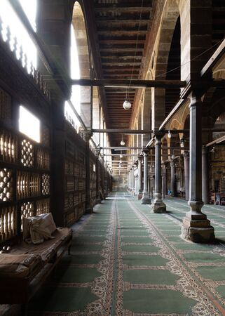 Corridor at public historic mosque of Amir Al-Maridani with wooden arabisk wall - Mashrabiya, Cairo, Egypt Stock Photo - 131871164