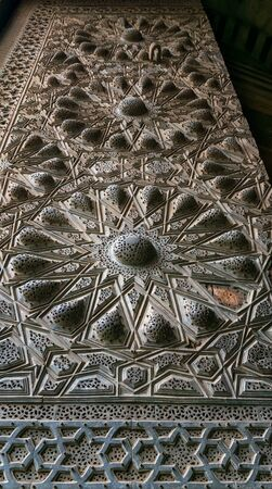Geometrical engraved bronze-plate decorations of the main entrance of public ancient mosque of Sultan Al Moaayad, Old Cairo, Egypt Stock Photo - 131870997