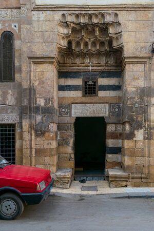 Cairo, Egypt- January 16 2016: Mosque entrance at Souq El Selah Street, Darb El Ahmar district, Old Cairo Stock Photo - 133073944
