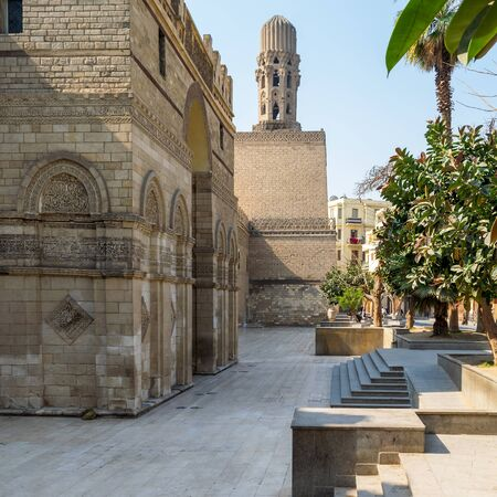 Cairo, Egypt- March 21 2015: Entrance of public historic Al Hakim Mosque known as The Enlightened Mosque with Minaret in the far end, located in Moez Street, Old Cairo Stock Photo - 133074287