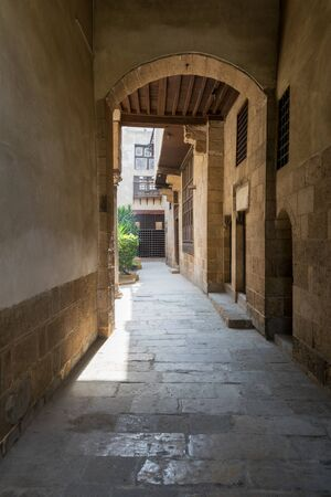 Stone bricks vaulted entrance of historic Beit El Sehemy house located in Moez street, Gamalia district, Cairo, Egypt Stock Photo - 131871108