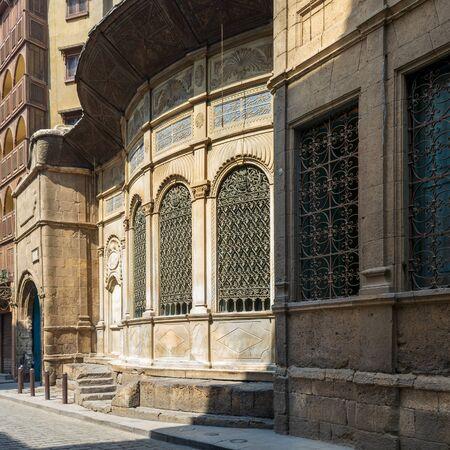 Moez Street with facade of Ottoman era historic Soliman Agha El Silahdar complex building, Old Cairo, Egypt Stock Photo - 131870663