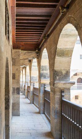 One of the arcades surrounding the courtyard of old historic public caravansary building - Wikala Bazaraa - Medieval Cairo, Egypt Stock Photo - 133246632