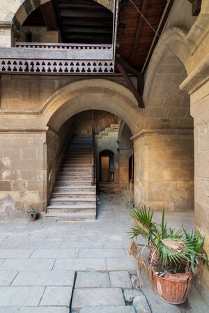 Exterior daylight shot of staircase going up leading to Wikalet Bazaraa historic public Caravansary building, suited in Gamalia district, Medieval Cairo, Egypt Stock Photo - 133246635