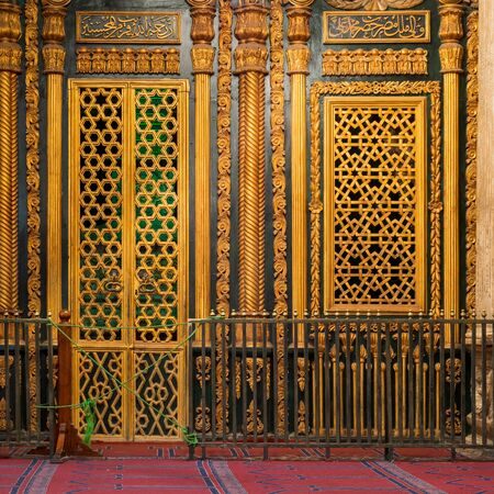 Tomb -Shrine - of Muhammad Ali Pasha with floral and geometric pattern golden decorations, at the great Mosque of Muhammad Ali - Alabaster Mosque - situated in the Citadel of Cairo in Egypt Stock Photo - 135039280