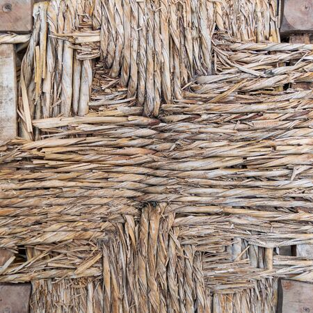 Weathered part of natural thatched wall of old countryside building Stock Photo - 135043409
