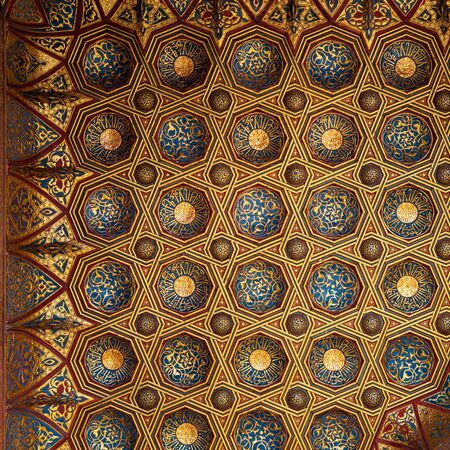 Golden floral pattern decorations, part of ceiling of Mausoleum of Sultan Qalawun, Sultan Qalawun Complex, located in Muizz Street, Gamalia district, Cairo, Egypt Stock Photo - 135060787