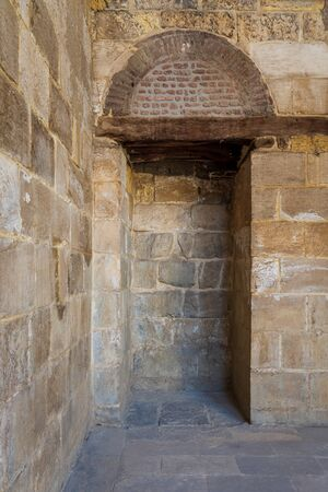Recessed frame - Niche - in old weathered stone bricks wall, Medieval Cairo, Egypt