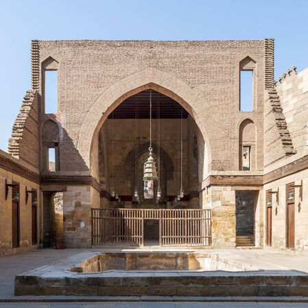 Main courtyard of public historic mosque of Sultan Al Nassir Qalawun with huge arch, Cairo, Egypt Stock Photo - 135069593