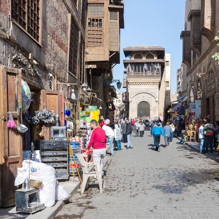 Cairo, Egypt- December 14 2019: Moez Street with local visitors and Sabil-Kuttab of Katkhuda historic building at the far end, Gamalia district, Old Cairo Editorial