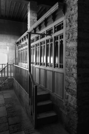 Black and white weathered porch of aged ornamental building at dark night Stock Photo - 135824448