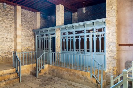 Changing rooms with blue wooden door shutters and wooden balustrades at abandoned historical traditional Turkish public bathhouse, Moez Street, Cairo, Egypt Stock Photo - 136441792