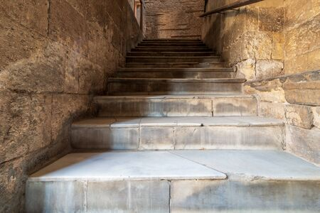 Day shot of old narrow stone staircase ending with bricks wall Stock Photo - 136667421