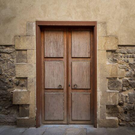 Wooden aged door on grunge stone bricks wall, Medieval Cairo, Egypt Stock Photo - 137441681