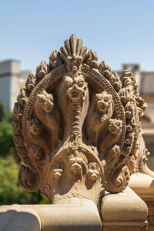 Hindu statue of snakes. One of the statues studding the terrace of the historical palace of Baron Empain, Cairo, Egypt