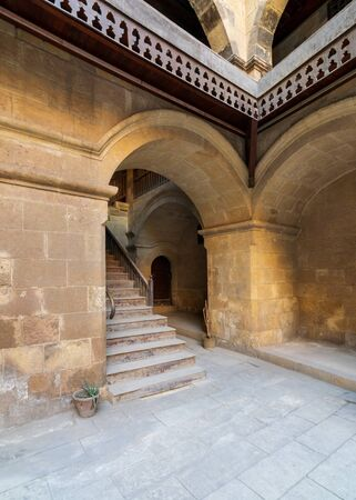 Exterior daylight shot of staircase going up leading to Caravansary - Wikala - of Bazaraa, suited in Gamalia district, Medieval Cairo, Egypt Stock Photo