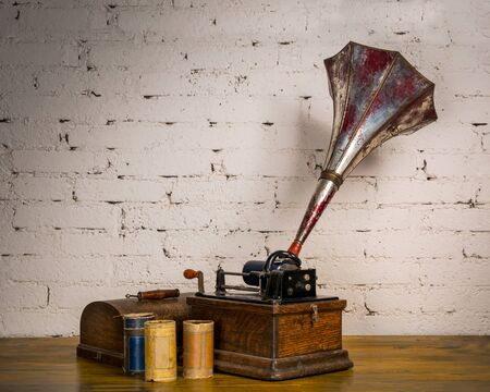 Edison Fireside Phonograph with three cylinder records Stock Photo